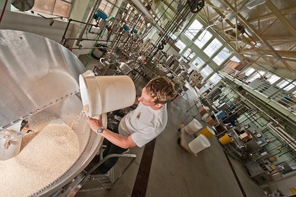 Dumping barley into a vat.